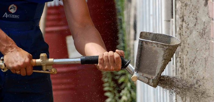 Фасад дома шубой | Механизация работ